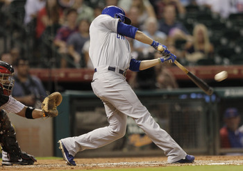Chicago Cubs' David DeJesus connects with a ball against the Houston Astros.