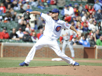 Cubs' pitcher Travis Wood delivers a pitch against the St. Louis Cardinals.