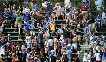 Cubs fans searching for a ball against the Houston Astros.