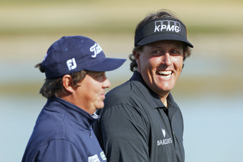 Jason Dufner with an almost-smile with Phil Mickelson.