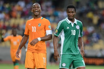 John Obi Mikel keeps a close eye on former Chelsea teammate Didier Drogba during the AFCON quarterfinal between Nigeria and Ivory Coast.