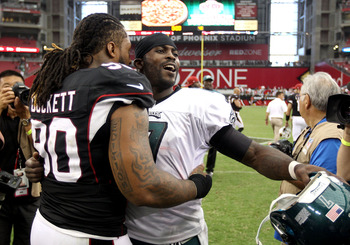 GLENDALE, AZ - SEPTEMBER 23:  Defensive tackle Darnell Dockett #90 of the the Arizona Cardinals and quarterback Michael Vick #7 of the Philadelphia Eagles talk after the NFL game at the University of Phoenix Stadium on September 23, 2012 in Glendale, Ariz