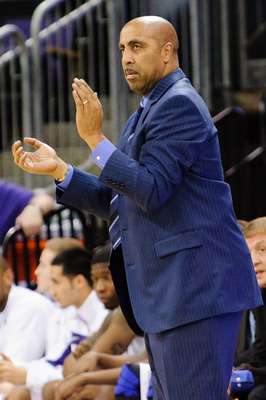 Washington head coach Lorenzo Romar.