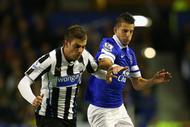 LIVERPOOL, ENGLAND - SEPTEMBER 30:  Kevin Mirallas of Everton battles with Davide Santon of Newcastle during the Barclays Premier League match between Everton and Newcastle United at Goodison Park on September 30, 2013 in Liverpool, England.  (Photo by Ju