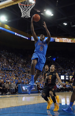 LOS ANGELES, CA - JANUARY 30:  Jordan Adams #3 of the UCLA Bruins drives to the basket for a layup past Chass Bryan #13 of the USC Trojans in the second half at Pauley Pavilion on January 30, 2013 in Los Angeles, California. USC defeated UCLA 75-71 in ove