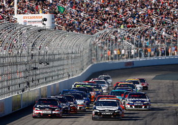 LOUDON, NH - SEPTEMBER 23:  Denny Hamlin, driver of the #11 FedEx Freight Toyota, and Brian Vickers, driver of the #55 Freightliner/Jet Edge Toyota, lead the field to a restart in the NASCAR Sprint Cup Series SYLVANIA 300 at New Hampshire Motor Speedway o