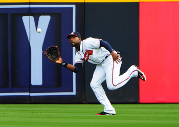 ATLANTA, GA - SEPTEMBER 4: Jason Heyward #22 of the Atlanta Braves makes a catch against the Colorado Rockies at Turner Field on September 4, 2012 in Atlanta, Georgia. (Photo by Scott Cunningham/Getty Images)