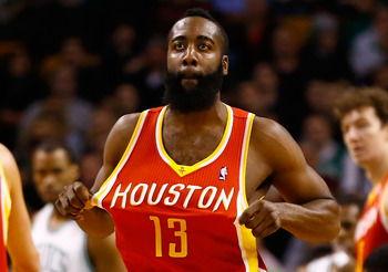 BOSTON, MA - JANUARY 11: James Harden #13 of the Houston Rockets straightens his jersey after being fouled against the Boston Celtics during the game on January 11, 2013 at TD Garden in Boston, Massachusetts. NOTE TO USER: User expressly acknowledges and