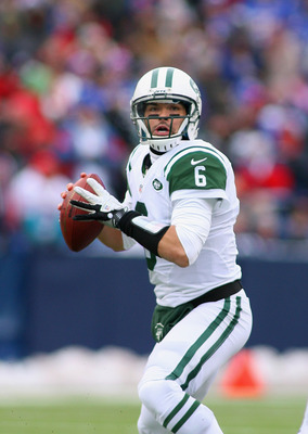Mark Sanchez drops back to pass in a game against the Buffalo Bills on December 30, 2012.