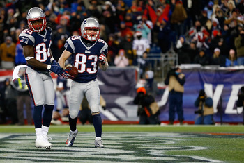 Wes Welker catches a touchdown pass against the Miami Dolphins on December 30, 2012.