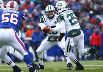 Tim Tebow hands the ball off in a game against the Buffalo Bills on December 30, 2012.