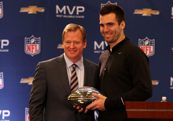 NFL Commissioner Roger Goodell poses for a picture with Super Bowl XLVII MVP Joe Flacco in a news conference.