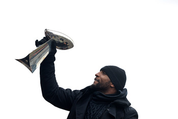 Ray Lewis hoists the Lombardi Trophy during the Ravens parade after winning Super Bowl XLVII against San Francisco.