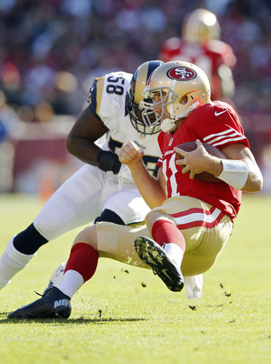 Alex Smith takes a hit from Rams linebacker Jo-Lonn Dunbar on November 11, 2012.