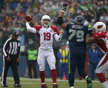 John Skelton throws a pass during a game against the Seattle Seahawks on December 9, 2012.