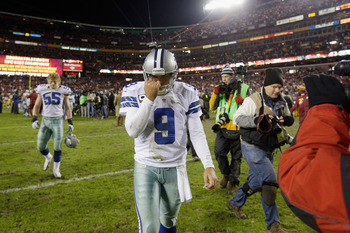 Tony Romo walks off the field after losing to the Wasington Redskins in the regular season finale on December 30, 2012.