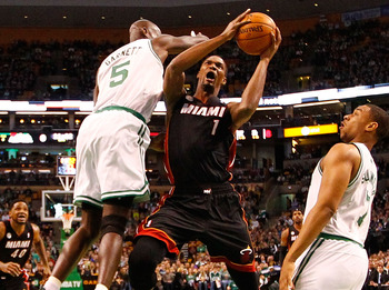 BOSTON, MA - JANUARY 27: Chris Bosh #1 of the Miami Heat goes up for a layup in front of Kevin Garnett #5 of the Boston Celtics during the game on January 27, 2013 at TD Garden in Boston, Massachusetts. NOTE TO USER: User expressly acknowledges and agrees