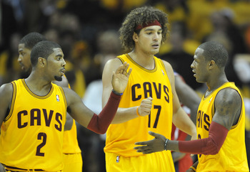 Oct 30, 2012; Cleveland, OH, USA; Cleveland Cavaliers point guard Kyrie Irving (2), center Anderson Varejao (17) and shooting guard Dion Waiters (3) celebrate in the fourth quarter against the Washington Wizards at Quicken Loans Arena. Mandatory Credit: D