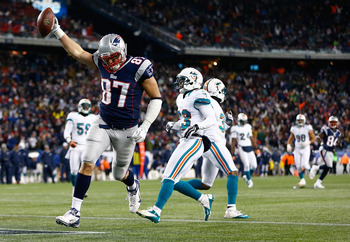 FOXBORO, MA - DECEMBER 30: Rob Gronkowski #87 of the New England Patriots crosses the goal line to score a touchdown in the second half against the Miami Dolphins during the game at Gillette Stadium on December 30, 2012 in Foxboro, Massachusetts. (Photo b