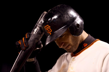 SAN FRANCISCO, CA - OCTOBER 25:  Marco Scutaro #19 of the San Francisco Giants reacts after an at bat against the Detroit Tigers during Game Two of the Major League Baseball World Series at AT&T Park on October 25, 2012 in San Francisco, California.  (Pho