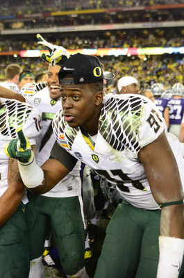 Jan. 3, 2013; Glendale, AZ, USA: Oregon Ducks defensive end Tony Washington (91) celebrates following the game against the Kansas State Wildcats during the 2013 Fiesta Bowl at University of Phoenix Stadium. Oregon defeated Kansas State 35-17. Mandatory Cr