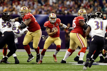 Colin Kaepernick uses both his speed and his arm