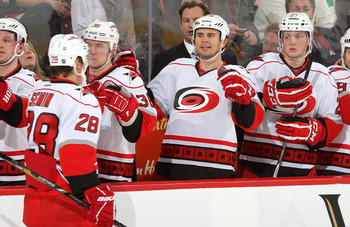 Alexander Semin celebrates with his teammates on the Carolina bench in a game against the Ottawa Senators on Feb. 7.