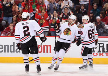 Chicago's Patrick Sharp skates over to celebrate with teammates after a goal against the Phoenix Coyotes on Feb.7.