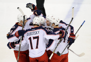 Brandon Dubinsky celebrates with teammates after a goal against Minnesota on Jan. 29.