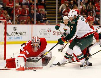Detroit's Jimmy Howard scrambles for a rebound against the Minnesota Wild on Jan. 25.