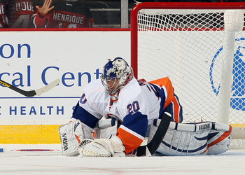 Islander's goalie Evgeni Nabokov freezes the puck against the New Jersey Devils on Jan. 31.