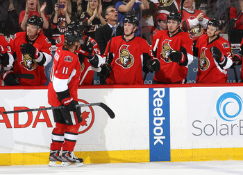 Ottawa's Milan Michalek celebrates with teammates after a goal against Carolina on Feb. 7.