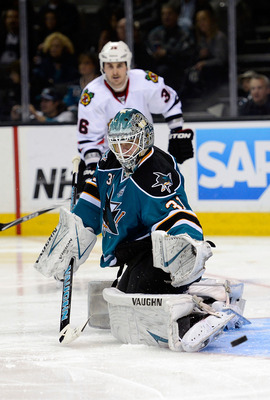 San Jose's Antti Niemi has the puck dribble of his pads against the Chicago Blackhawks on Feb. 5.