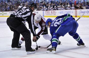 Vancouver's Henrik Sedin prepares for a faceoff against the Colorado Avalanche on Jan. 30.