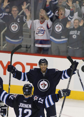 Winnipeg's Evander Kane scores a goal and celebrates against the New York Islanders on Jan. 27.