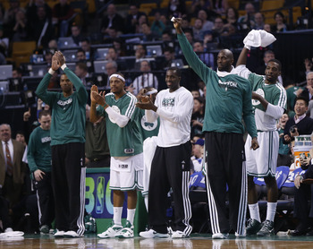 Feb 7, 2013; Boston, Massachusetts, USA; Boston Celtics forward/center Kevin Garnett (5) raises his right arm in celebration during the last minutes of the fourth quarter against the Los Angeles Lakers at TD Banknorth Garden.  The Boston Celtics won 116-9