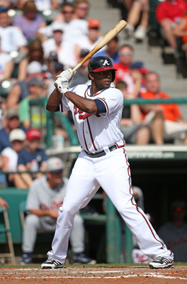 LAKE BUENA VISTA, FL - FEBRUARY 22:  Justin Upton #8 of the Atlanta Braves bats during the game against the Detroit Tigers on February 22, 2013 in Lake Buena Vista, Florida. The Tigers defeated the Braves 2-1.  (Photo by Leon Halip/Getty Images)