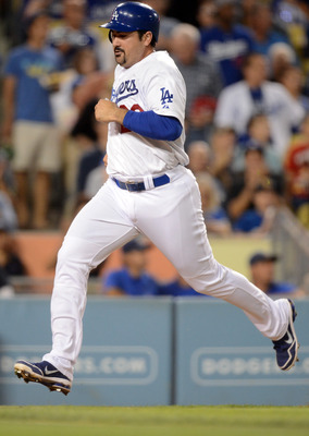 LOS ANGELES, CA - SEPTEMBER 28:  Adrian Gonzalez #23 of the Los Angeles Dodgers scores a run off a Andre Ethier #16 double for a 1-0 lead over the Colorado Rockies during the second inning at Dodger Stadium on September 28, 2012 in Los Angeles, California