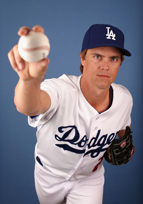 GLENDALE, AZ - FEBRUARY 17:  Pitcher Zack Greinke #21 of the Los Angeles Dodgers poses for a portrait during spring training photo day at Camelback Ranch on February 17, 2013 in Glendale, Arizona.  (Photo by Christian Petersen/Getty Images)