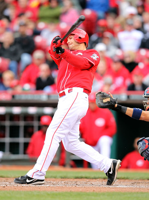 CINCINNATI, OH - APRIL 11:  Chris Heisey #28 of the Cincinnati Reds hits a single to drive in the game winning run in the bottom of the ninth inning of the game against the  St Louis Cardinals at Great American Ball Park on April 11, 2012 in Cincinnati, O