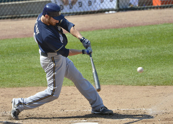 CHICAGO, IL - AUGUST 30:  Jonathan Lucroy #20 of the Milwaukee Brewers connects on a grand slam scoring teammates Rickie Weeks #23, Ryan Braun #8 and Corey Hart #1 during the third inning against the Chicago Cubs at Wrigley Field on August 30, 2012 in Chi