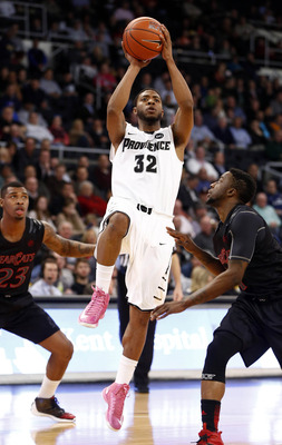 Feb 6, 2013; Providence, RI, USA; Providence Friars guard Vincent Council (32) shoots the ball against Cincinnati Bearcats guard Cashmere Wright (right) during the first half at Dunkin' Donuts Center.  Mandatory Credit: Mark L. Baer-USA TODAY Sports