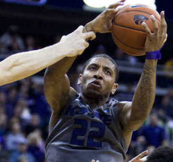 Senior Rodney McGruder grabbing a rebound against Florida.  {Photo by SHANE KEYSER | Kansas City Star)