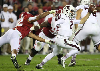 Manziel escapes an Alabama defender to extend the play for the Aggies