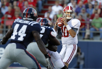 A.J. McCarron eyes his receiver against the Rebels pass rush