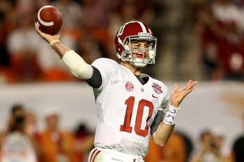 A.J. McCarron heaves the ball downfield for the Tide