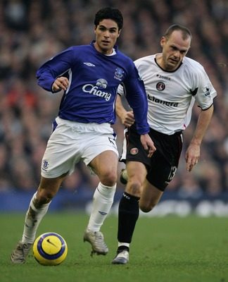 Mikel Arteta and Danny Murphy do battle back in 2006.
