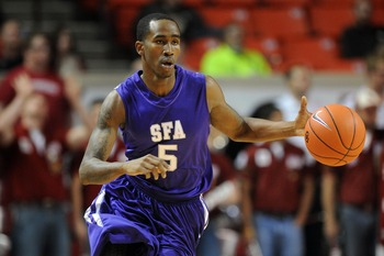 Antonio Bostic brings the ball up the court in Stephen F. Austin's win at Oklahoma.