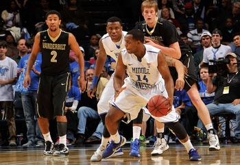 Marcos Knight dribbles inside against Vanderbilt in Middle Tennessee's 56-52 win.
