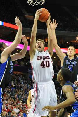 Clint Mann of Davidson goes strong to the basket against Duke.